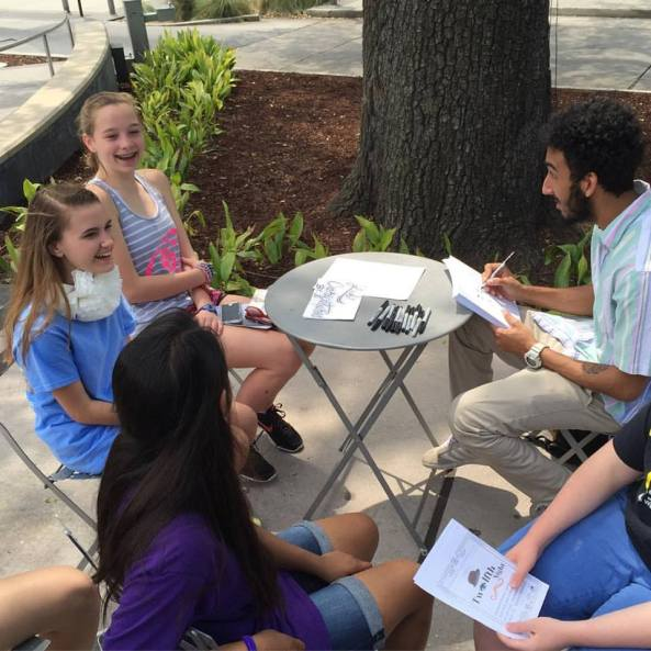 Young Professionals with Caricature Artist
